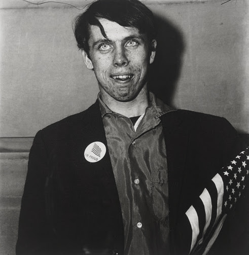 Patriotic Young Man with Flag, NYC, 1967, Diane Arbus